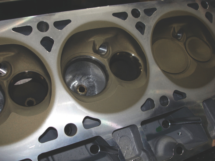 Heat reflective ceramic metallic coatings inside the combustion chamber can improve thermal efficiency by reducing heat transfer into the head.