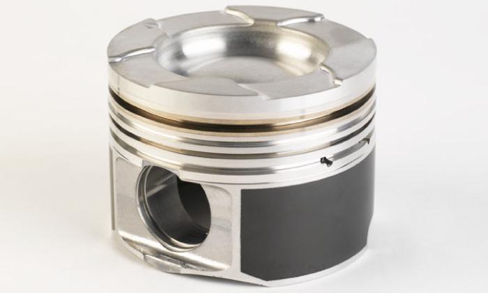 Cast Duramax piston with steel top ring land insert.